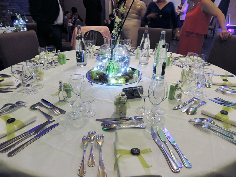 A wedding table with badges